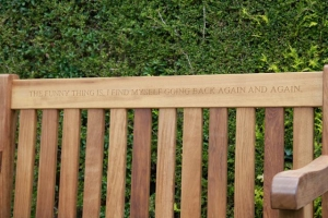 Bench in the Boathouse garden with a quotation from Dylan's daughter Aeronwy